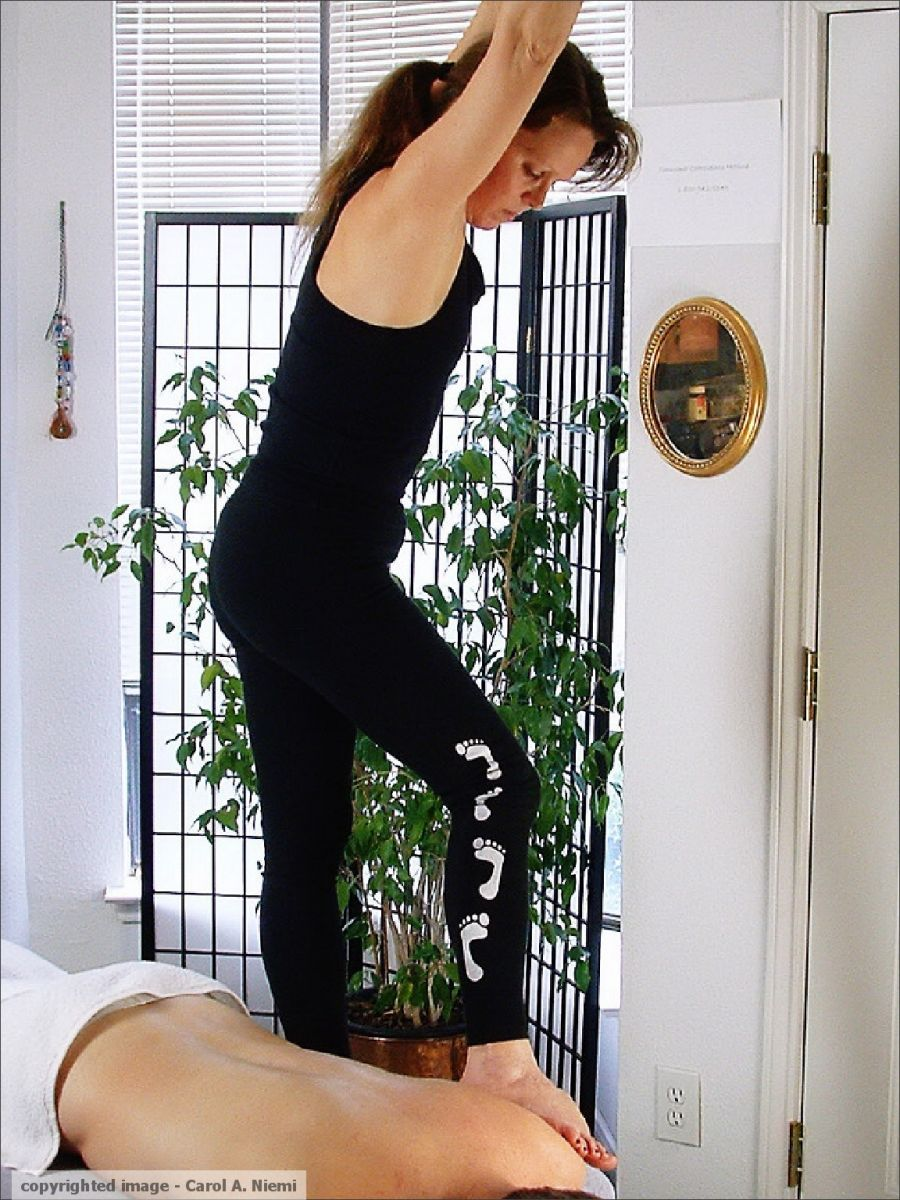Carol Niemi gives Ashiatsu along spinal erectors and over shoulder. Mmm. . . copyrighted image