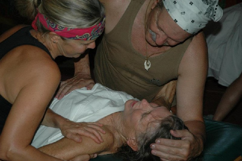 Carol practices Sacred Lomi with fellow therapists